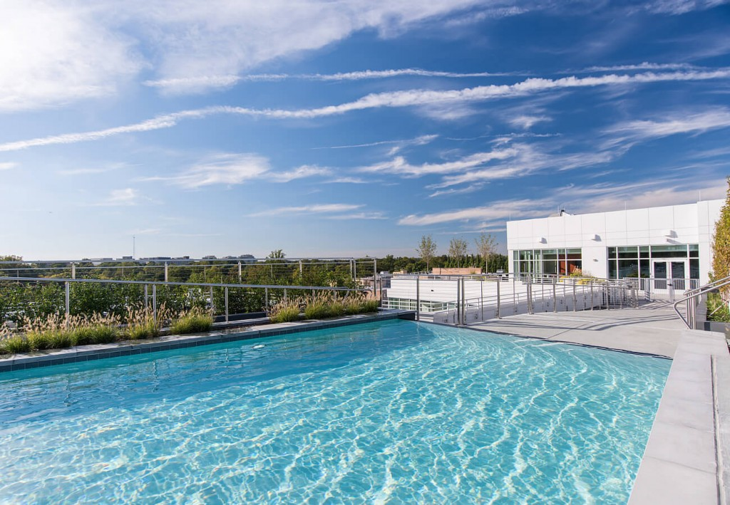 Cool off with a dip in the rooftop swimming pool and  infinity spillway